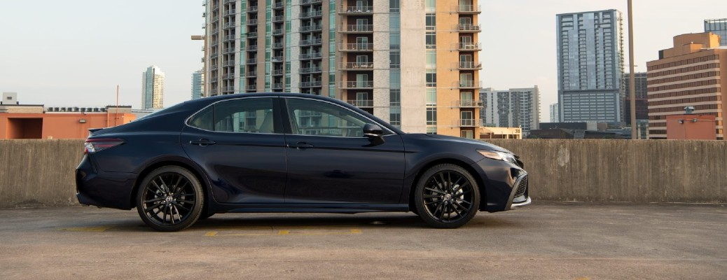 2021 Toyota Camry dark blue parked on rooftop