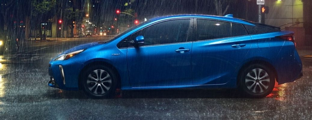 2021 Toyota Prius Electric Storm Blue color parked on the road