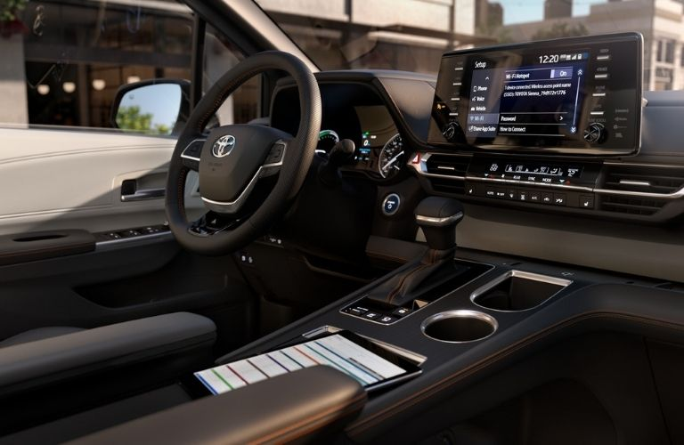 A close-up of the steering wheel and dashboard in the 2021 Toyota Sienna
