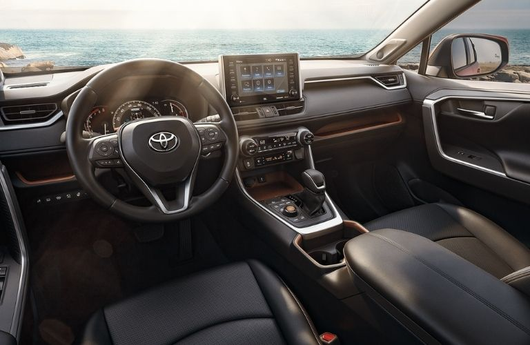 A close-up of the steering wheel and dashboard in the 2021 Toyota RAV4