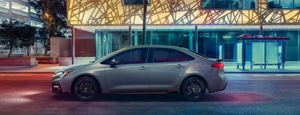 2022 Toyota Corolla Cement parked outside a building