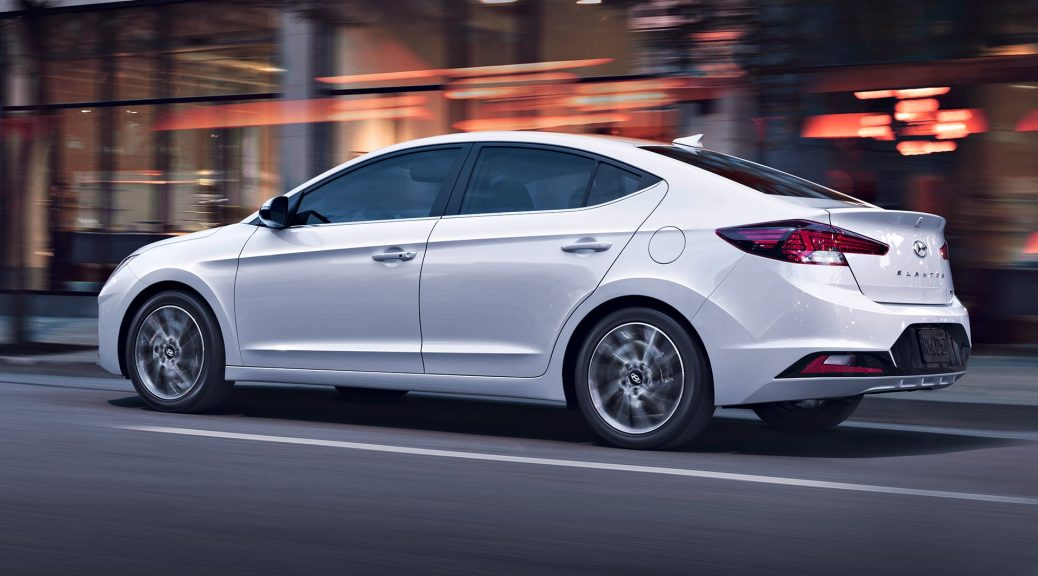 2020 Hyundai Elantra gliding through city streets with safety and ease