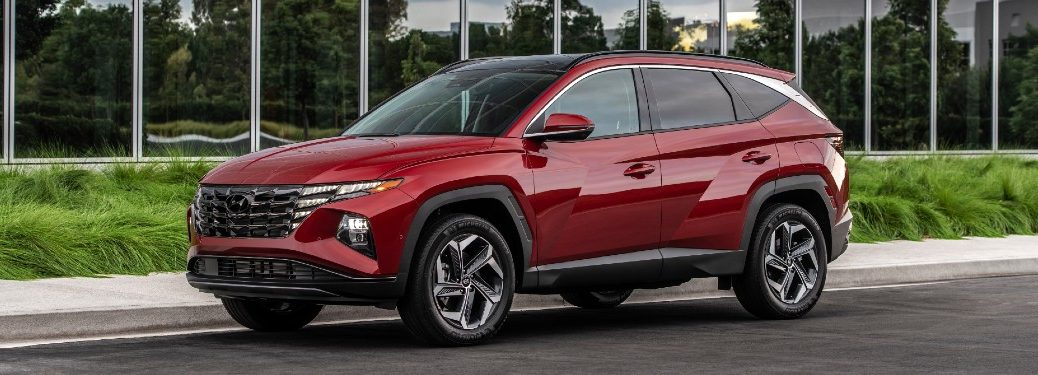 Front driver angle of a red 2022 Hyundai Tucson