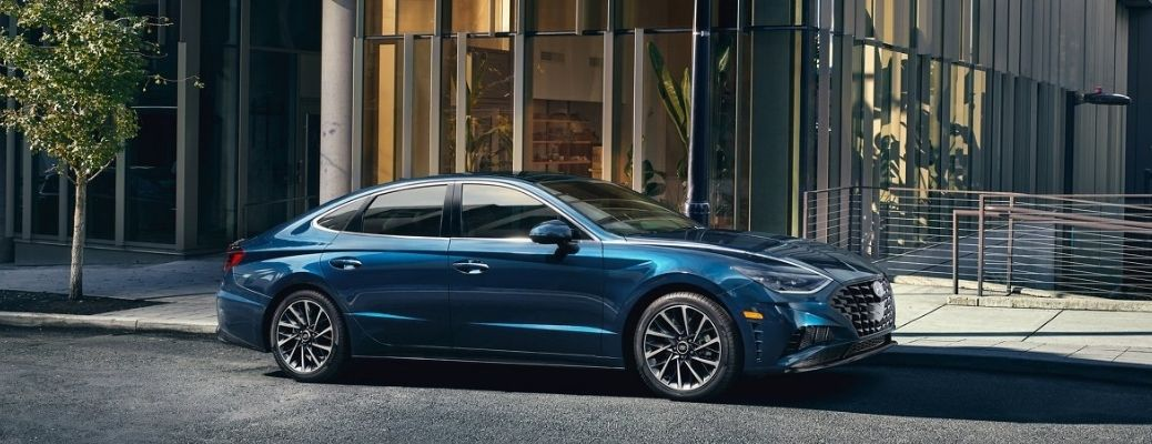 The 2021 Hyundai Sonata parked in front of a building