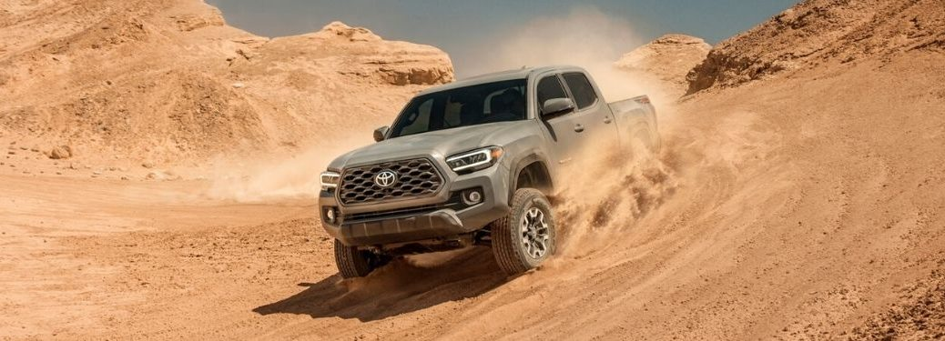 Gray 2020 Toyota Tacoma Driving Through Sand