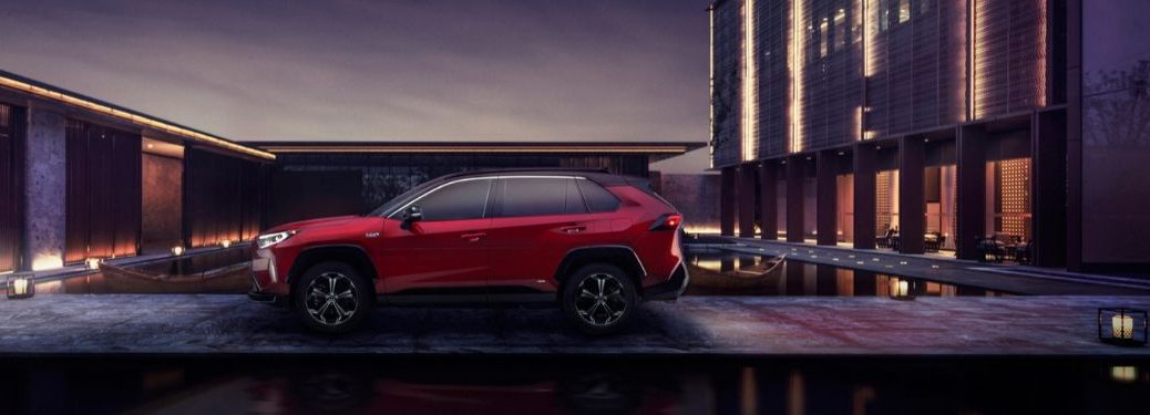 Red 2021 Toyota RAV4 Prime Side Exterior in a Driveway