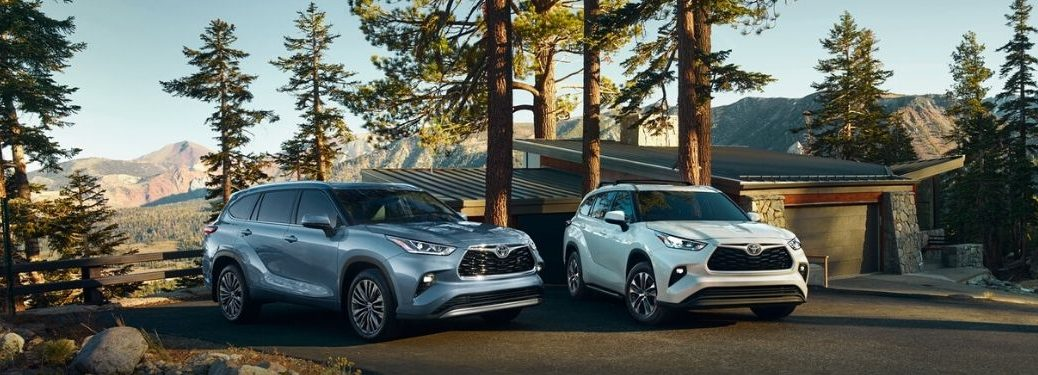 Blue and White 2020 Toyota Highlander Models at a Mountain Cabin
