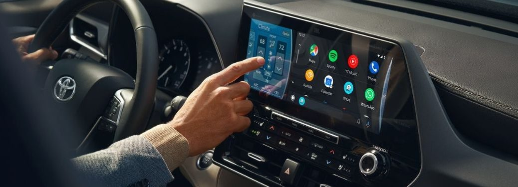 Close Up of Man Using 2020 Toyota Highlander Toyota Entune 3.0 Touchscreen Display
