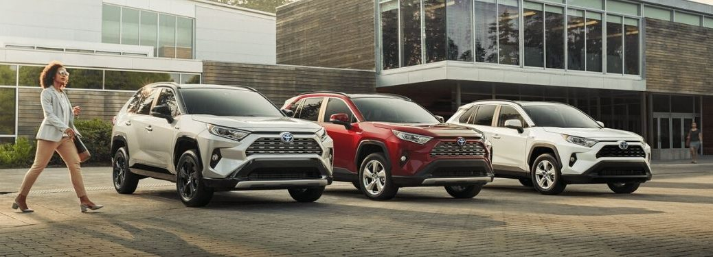 Silver, Red and White 2020 Toyota RAV4 Models in a Parking Lot