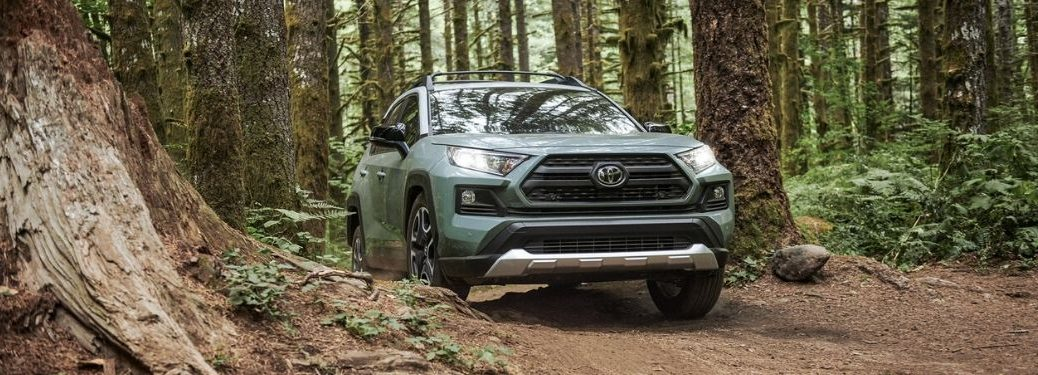 Green 2020 Toyota RAV4 on a Forest Trail