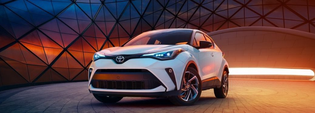 White 2020 Toyota C-HR in Front of Modern Building at Sunset