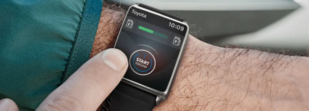 Close Up of Man Using Toyota Remote Connect on a Smartwatch