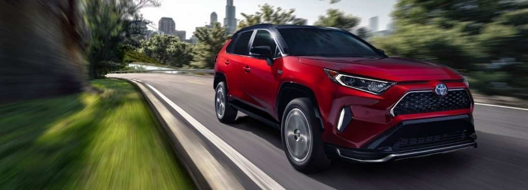 Red 2021 Toyota RAV4 Prime on Country Road