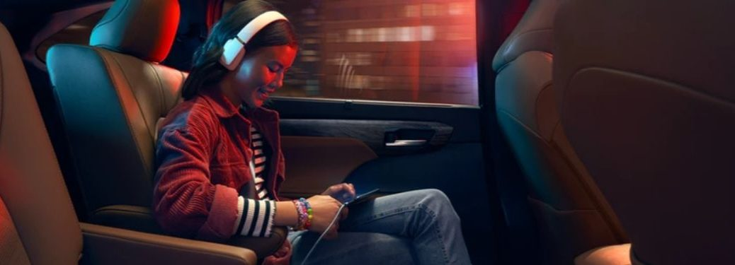 Girl Using Wi-Fi Connect in the Back of a 2020 Toyota Highlander