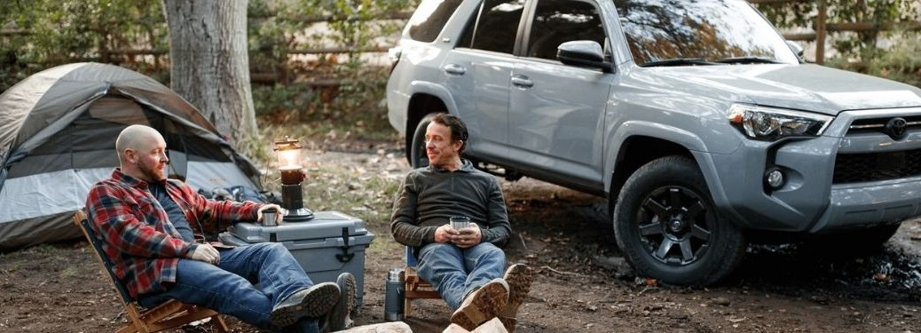 Two Men Sitting at a Campsite with a Gray 2021 Toyota 4Runner