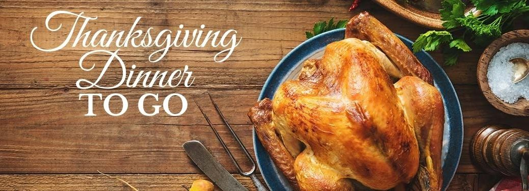 Turkey on a Table with White Thanksgiving Dinner To Go Text