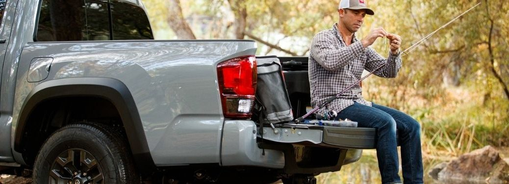 Man Sitting on the Tailgate of Gray 2021 Toyota Tacoma
