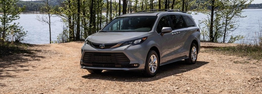 Gray 2022 Toyota Sienna Woodland Special Edition by a Lake