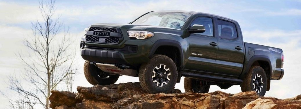 Green 2021 Toyota Tacoma with Lift Kit on Rock Formation
