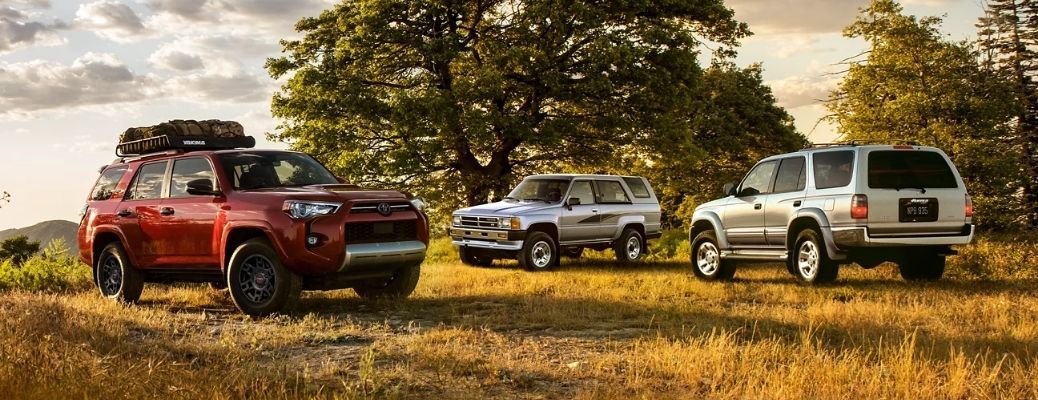 View of the 4Runner parked side by side facing front and back on a grass terrain