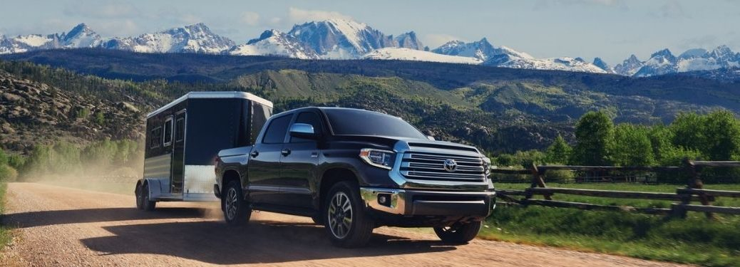 Black 2021 Toyota Tundra Towing a Trailer in a Desert