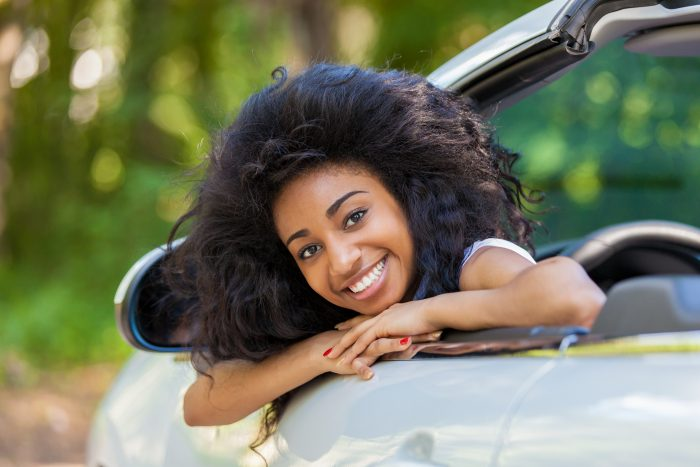 Young Black Teenage Driver Seated In Her New Convertible Car