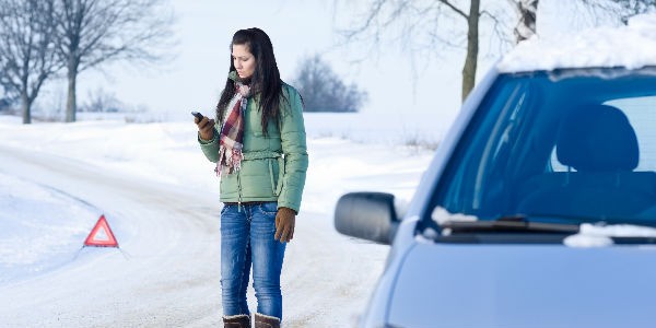 Girl in Winter Standing by her Car