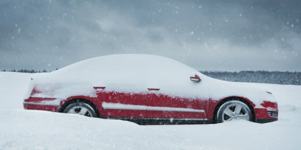 Car Stuck in the Snow in Blizzard