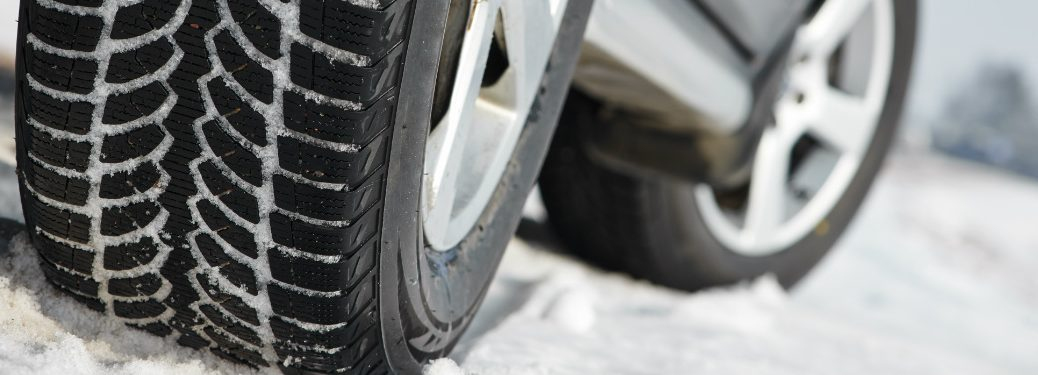close up of tires on snow