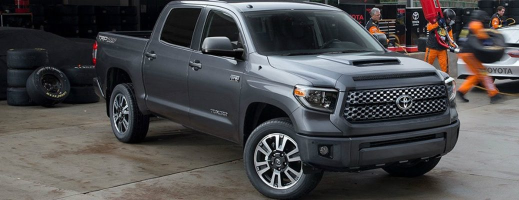 Gray 2018 Toyota Tundra parked in racing pit area