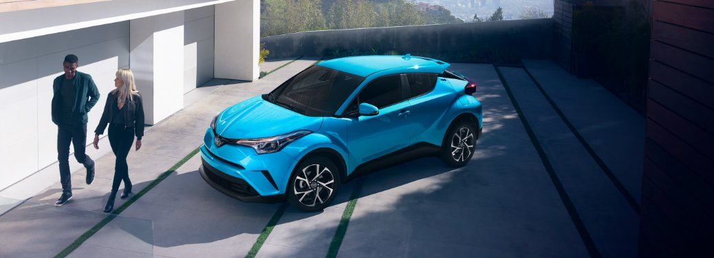aerial view of blue 2019 toyota c-hr in home driveway