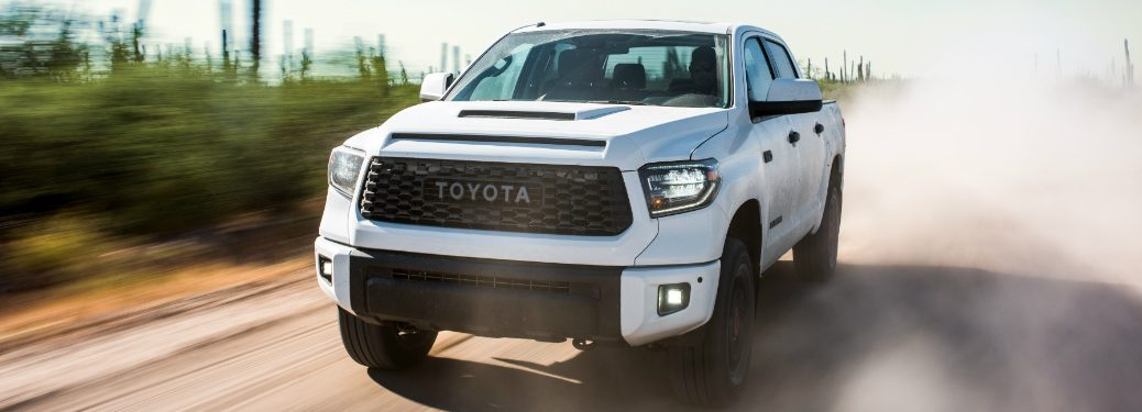 front and side view of white 2019 toyota tacoma