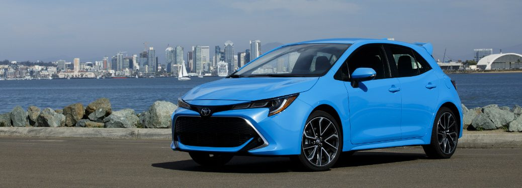 front and side view of blue 2019 toyota corolla hatchback