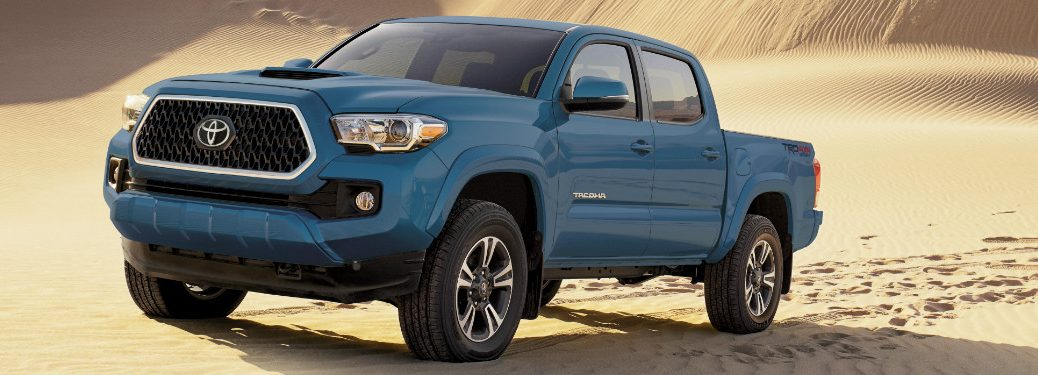 front and side view of blue 2019 toyota tacoma