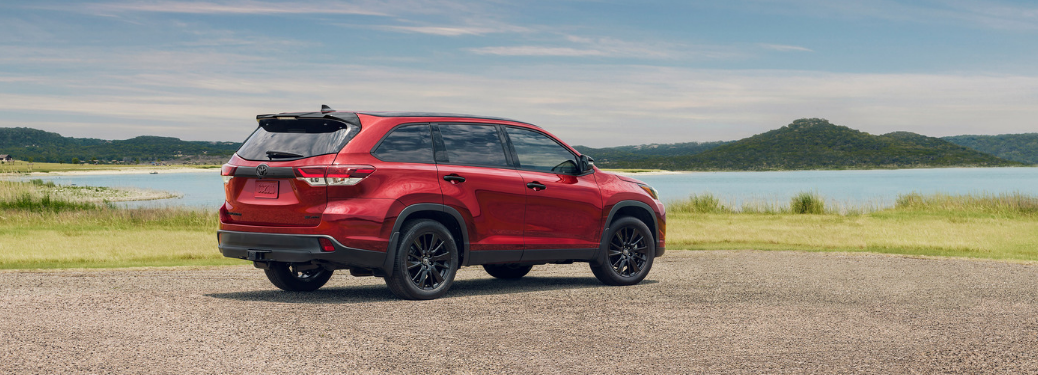 rear and side view of red 2019 toyota highlander