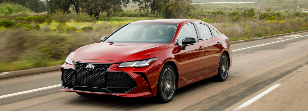 front and side view of red 2019 toyota avalon