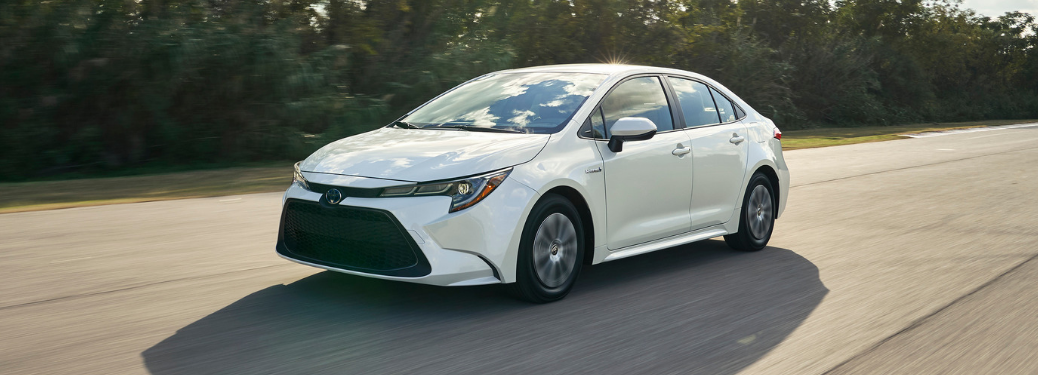 front and side view of white 2020 toyota corolla hybrid