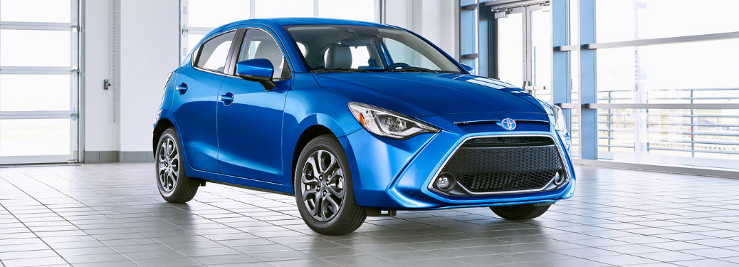 front and side view of blue 2020 toyota yaris hatchback