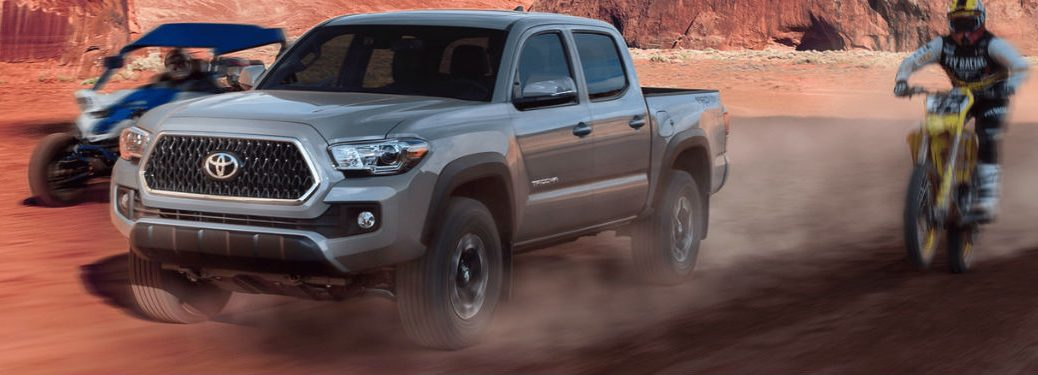 Toyota Tacoma driving on off-road trail