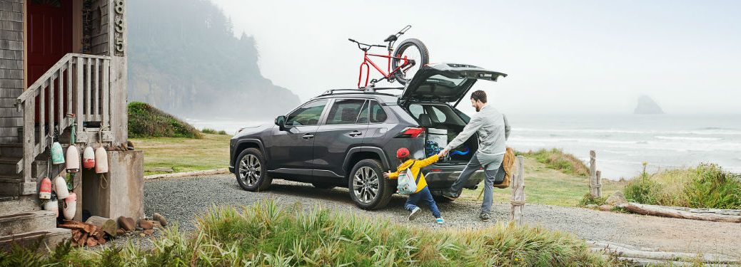 Toyota RAV4 with a bike on top of it and rear lift gate open