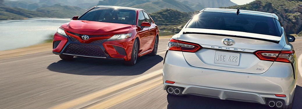 Two 2019 Toyota Camry sedans driving on a road