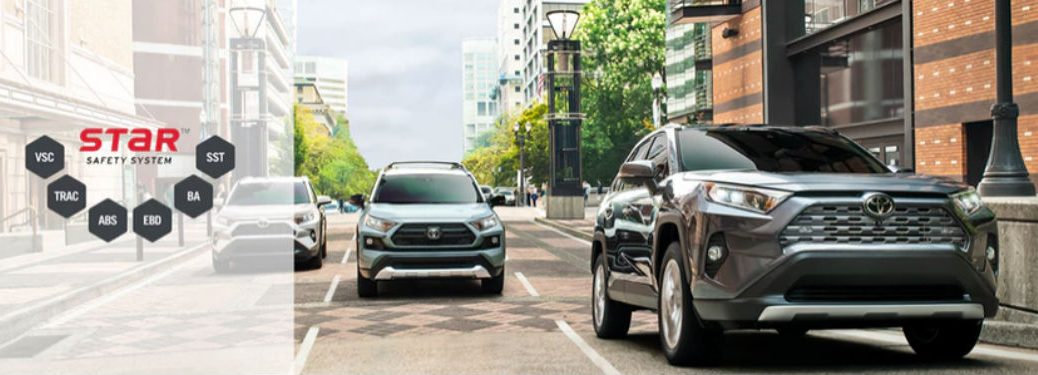 Two 2019 Toyota RAV4 crossovers driving on a road