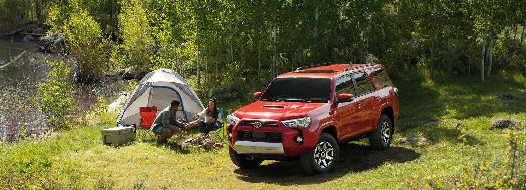 2020 Toyota 4Runner parked on grass next to tent