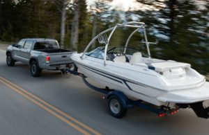 2020 Toyota Tacoma on a road towing a boat