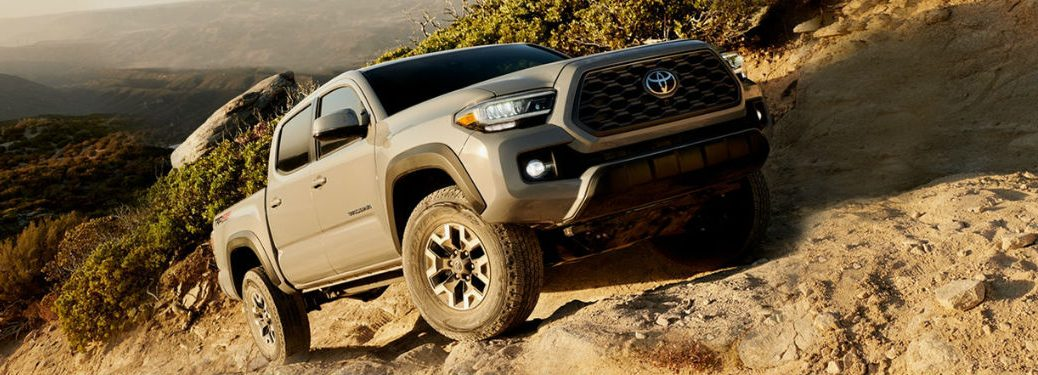2020 Toyota Tacoma driving up a hill