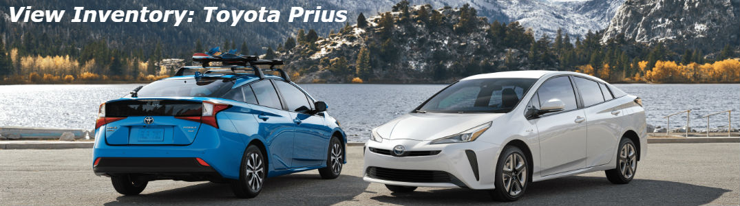 Two Toyota Prius cars parked next to each other