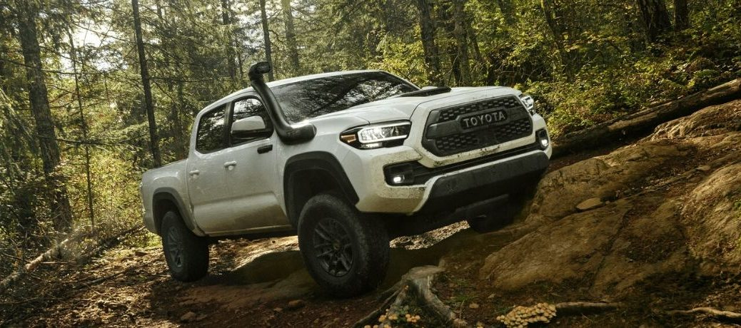 2020 Toyota Tacoma on path in woods from exterior front view
