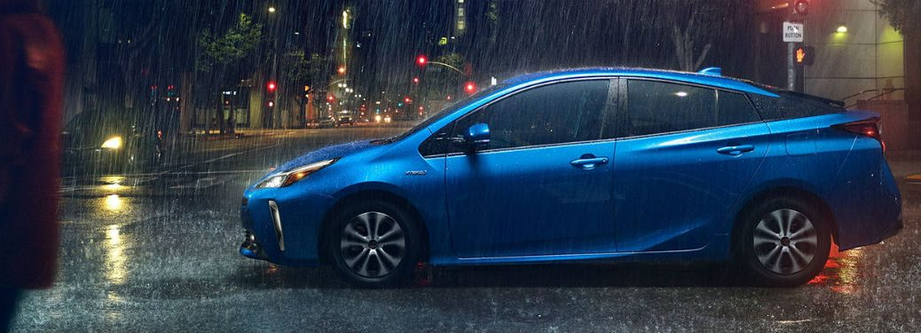 2020 Toyota Prius blue exterior driver side stopped raining outside