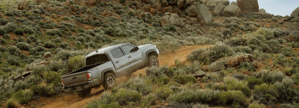2020 Toyota Tacoma exterior rear fascia passenger side driving up off road hill
