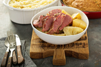 bowl of corned beef and cabbage on wood serving platter